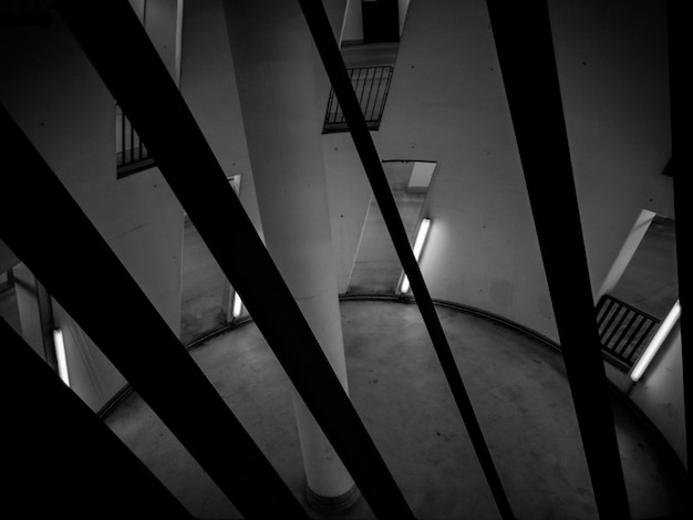 Black and white photo of circular room with pillar in center