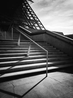 Black and white photo of metallic railing