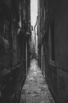 Black and white photo of a narrow alleyway