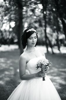 Black-and-white photo portrait of bride with bouquet photo in retro style
