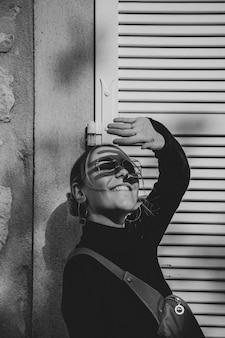 Black and white photo of stylish woman