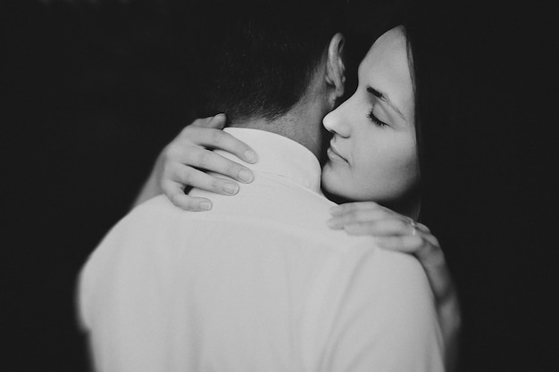 Black and white photo of young couple in love