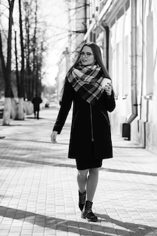 Black and white photo of a young girl on a walk