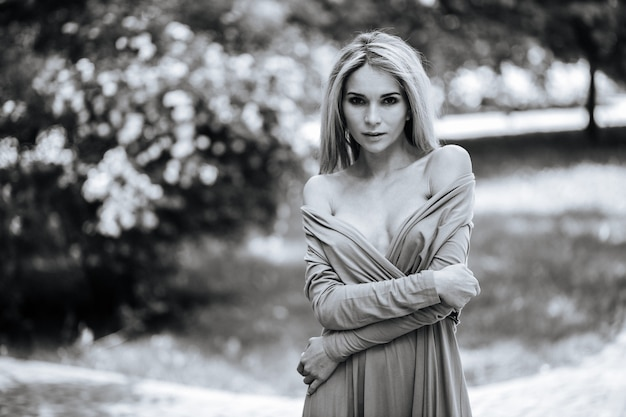 Black and white portrait of a glamorous girl outdoors