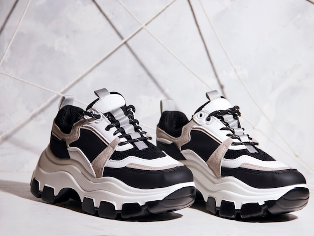 Black and white sneakers on a light background. sports shoes concept