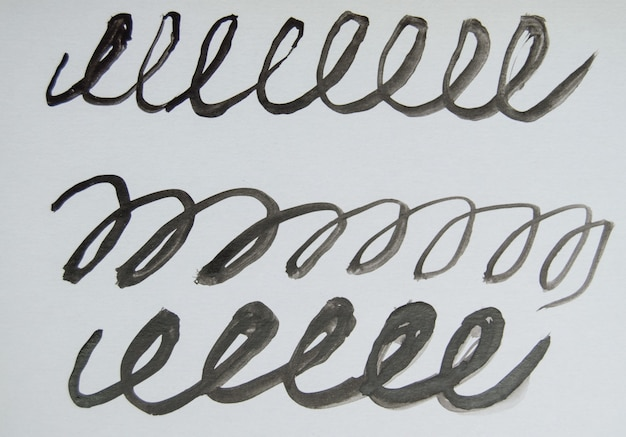 Black and white watercolor drawing, signature with monograms and loops, simple abstract pattern