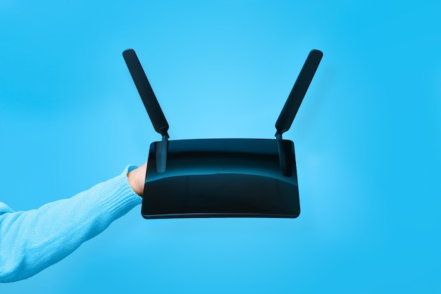 Black wifi router on hand
