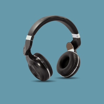 Black wireless headphone isolated on beautiful pastel color