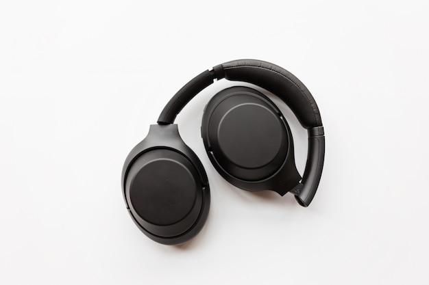 Black wireless headphones on white background