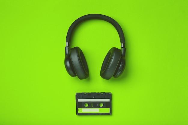 Black wireless headphones with audio cassette tape