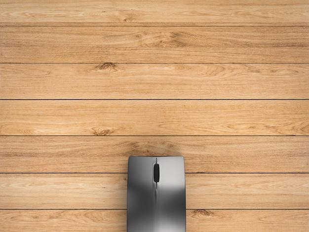 空白のスペースと木製の背景に黒のワイヤレスマウス