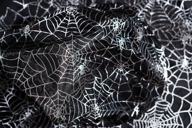 Black witch hat with a pattern of cobwebs close up