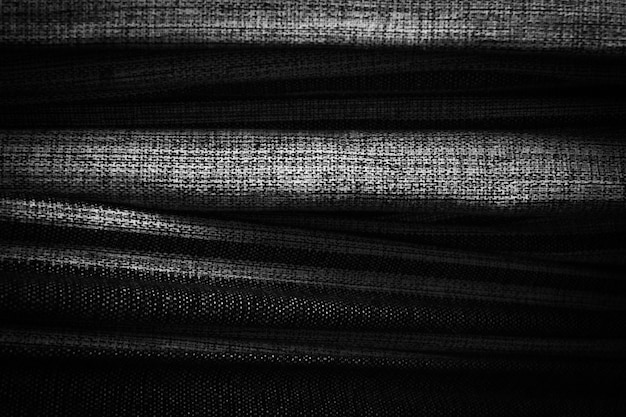 Черный с волнистой текстурой ткани.