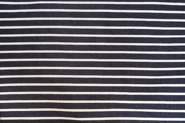 Black with white stripes seamless fabric.
