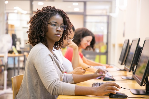 Black woman adult student working in computer class