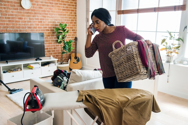 Black woman cleaning home housework