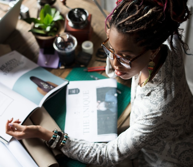 Black woman on her desk at a magazine company