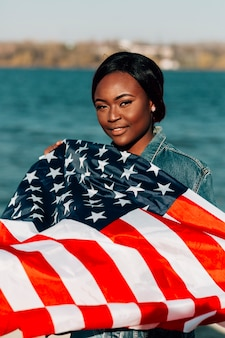 Black woman holding american flag
