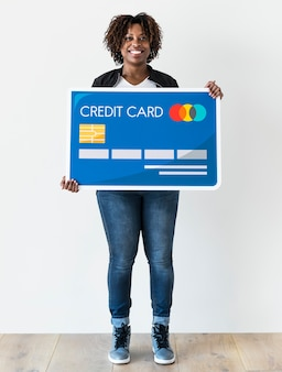 Black woman holding credit card isolated