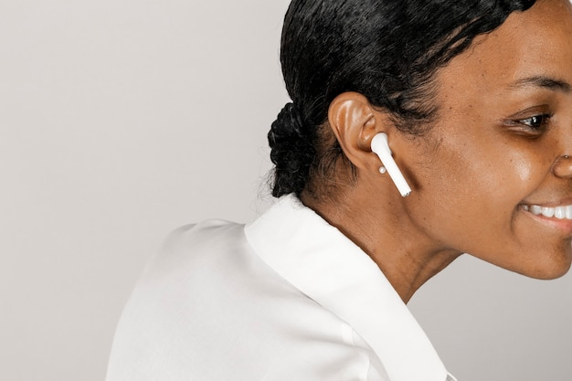 Black woman listening to music