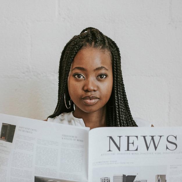 Black woman reading a newspaper