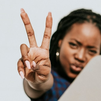 Black woman showing a v sign