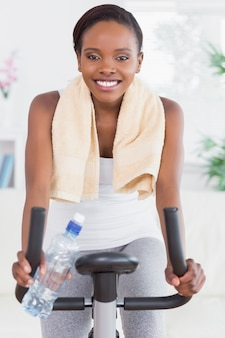 Black woman sitting on an exercise bike