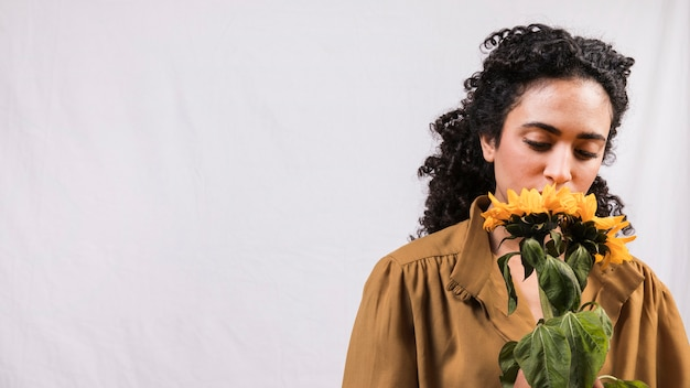 Black woman smelling flower