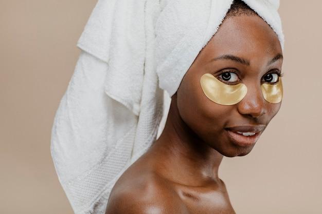 Black woman wearing a golden eye mask