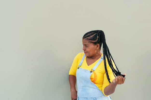 Black woman with braids in the open air