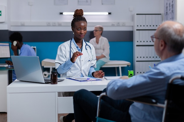 Black woman with doctor occupation giving advice