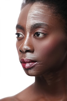 Black woman with half face on makeup, beauty concept