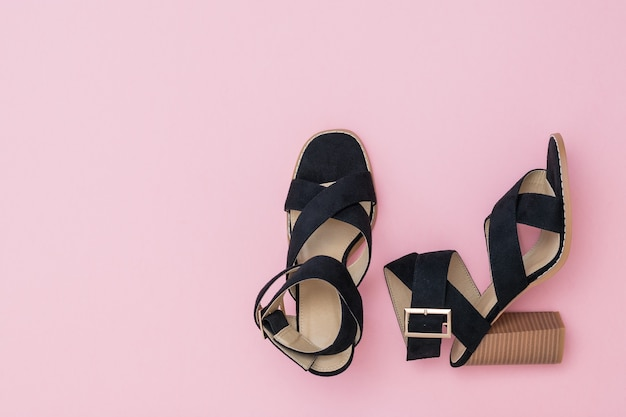 Black women's summer shoes in the right corner of the pink.
