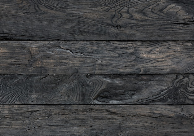 黒い木の背景焦げた板は黒い染み板を塗った