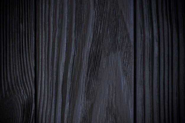 어두운 가장자리와 검은 나무 배경