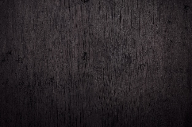 Black wood background with scratches and dust. detail of scratched wooden surface.