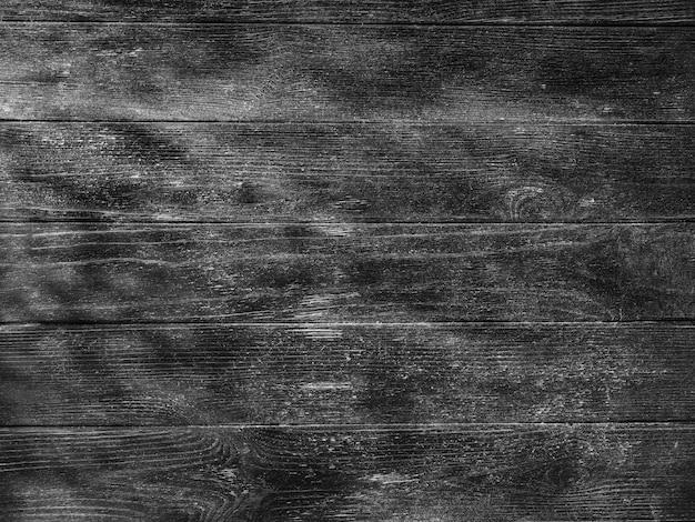 自然光と黒い木のテーブルの質感