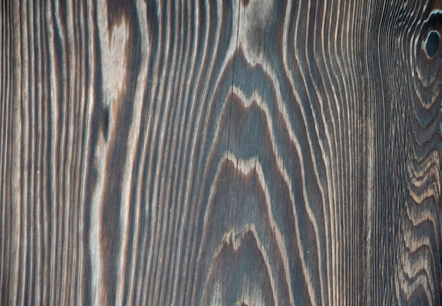 Black wood texture background.