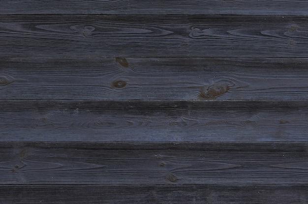 黒の木製の背景。黒板。グランジテクスチャ
