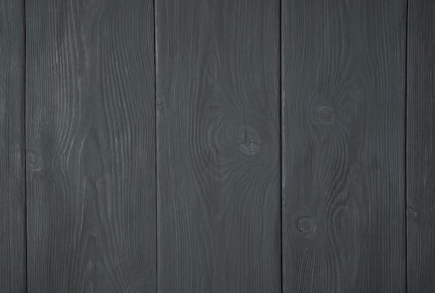 黒の木製の背景、クローズ アップ。木の質感。水平ビュー。