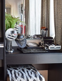 Black wooden dressing table with accessories at home