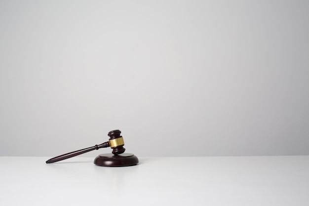 Black wooden gavel put on white desk table