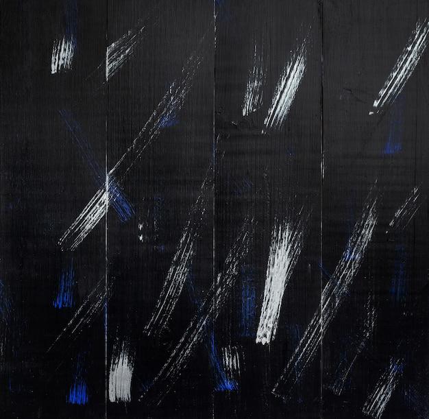 Черные деревянные доски с белыми и синими мазками