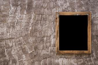Black wooden slate on wall