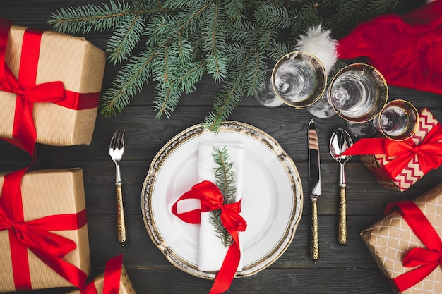 Black wooden table with stylish christmas table setting