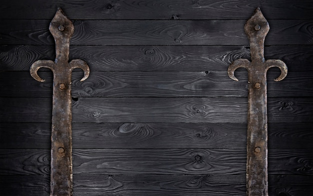 Black wooden texture with old metal elements