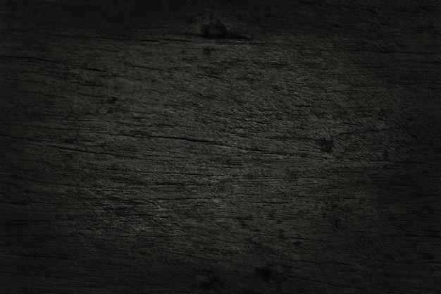 黒い木製の壁、古い自然のパターンを持つ樹皮の木の質感。