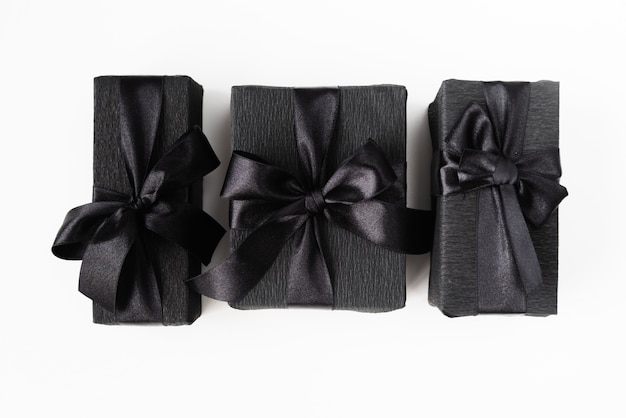 Black wrapped gifts on plain background