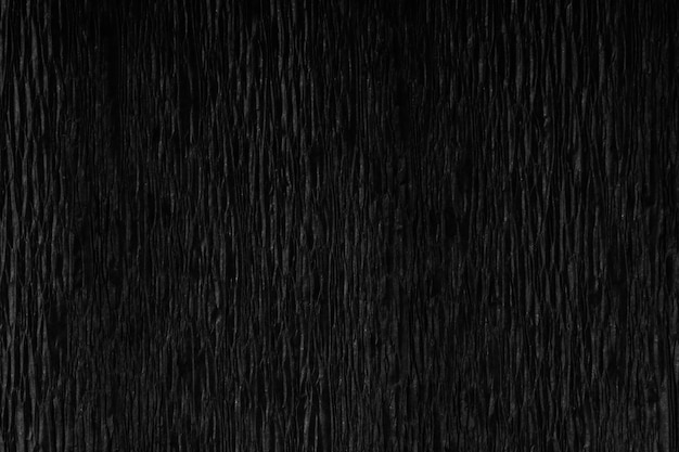 Black wrinkled paper texture with soft light.