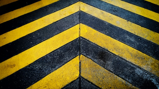 Black and yellow caution warning  patten background on the floor.